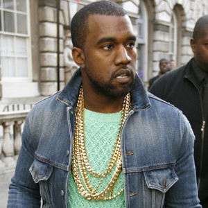 Kanye West - something to aspire to - weighing down his inflated ego with  20 grand worth of gold.